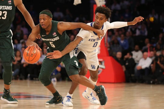 Kentucky Wildcats guard Ashton Hagans (0) attempts to steal the ball from Michigan State Spartans guard Cassius Winston (5) at Madison Square Garden.