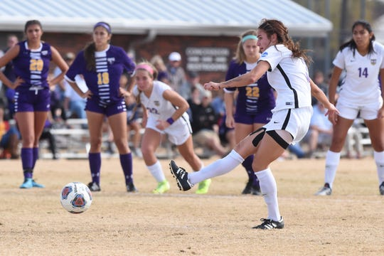 Hardin-Simmons midfielder Madelyn Dowell (3) delivers a penalty kick against Mary Hardin-Baylor in the ASC tournament championship at the HSU Soccer Complex.