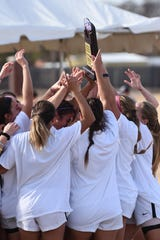 The Hardin-Simmons women's soccer team raises its 17th-straight American Southwest Conference tournament trophy after defeating Mary Hardin-Baylor 2-0 at the HSU Soccer Complex on Sunday. The Cowgirls will compete in the NCAA tournament beginning Saturday.