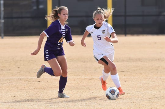 Hardin-Simmons midfielder Michaela Sabrsula (5) turns past Mary Hardin-Baylor's Dannah Fritschle (10) in the ASC tournament championship game.
