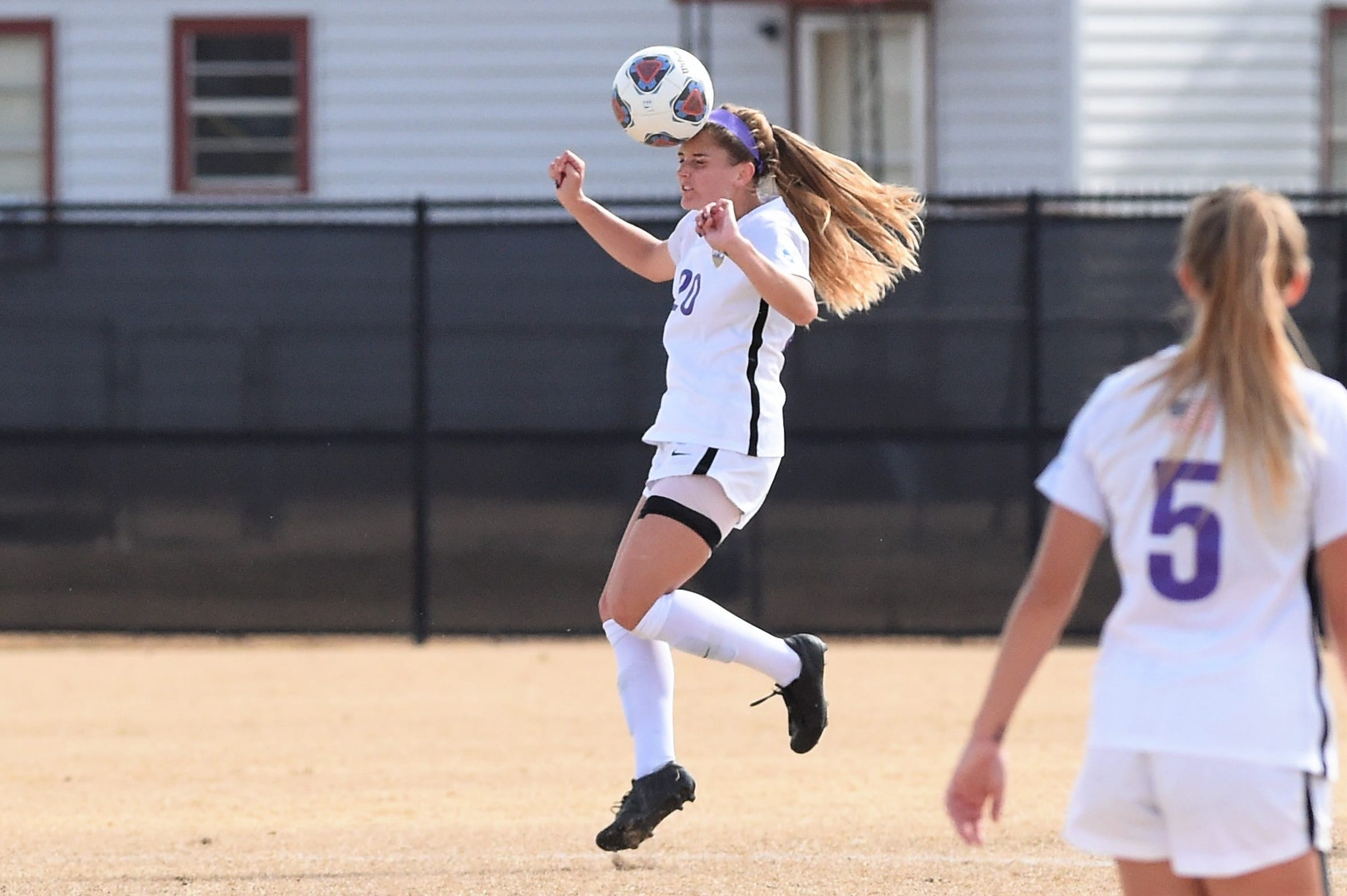 Hardin-Simmons midfielder Morgan McAdams (20) heads the ball against Mary Hardin-Baylor in the ASC tournament championship at the HSU Soccer Complex on Sunday, Nov. 10, 2019. The Cowgirls won 2-0 for their 17th-straight tournament title.