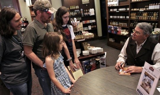 "The Salyers family - mom Jeniffer, dad Randy and daughters Kenlee, a Thomas Elementary second-grader, and Anicia, a freshman at Abilene High - had two books signed by ""Hank the Cowdog"" author John Erickson on Sunday at Texas Star Trading Co. Kenlee said she enjoys ""the humor"" the most. The family has two dogs."
