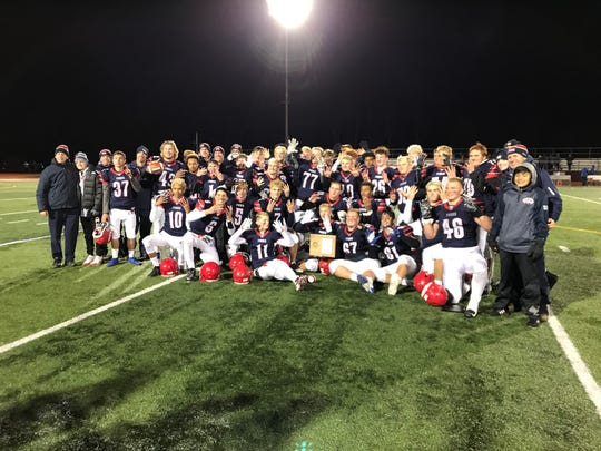 Chenango Forks players celebrate their 28-12 Section 4 Class B title-game victory over Maine-Endwell on Saturday at Johnson City.