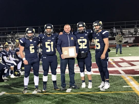 From left, Susquehanna Valley's Mitchell Knapp, Zachary Lawrence, coach Mike Ford, Patrick Enright and Mitchell Enright pose with the championship plaque.