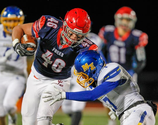 Chenango Forks' Lucas Scott has contact from Maine-Endwell's Nick DeLucia in the 1st quarter during Section 4 football Class B title game at Johnson City High School on Saturday, November 9, 2019. 