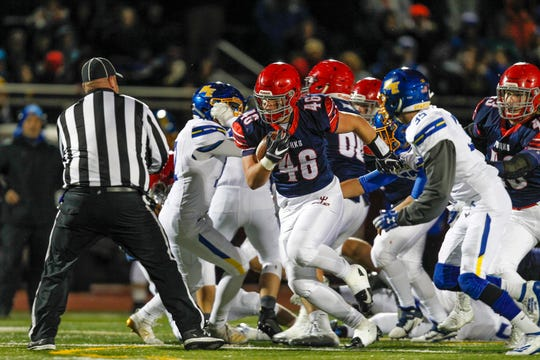 Chenango Forks' Lucas Scott blasts past Maine-Endwell's defense in the 1st quarter during Section 4 football Class B title game at Johnson City High School on Saturday, November 9, 2019.
