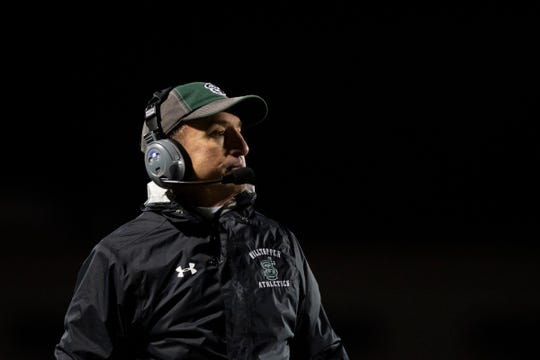 St. Johnsbury head coach Rich Alercio watch the action on the field during the DI football championship game between St. Johnsbury Hilltoppers and the Burr and Burton Bulldogs at Rutland High School on Saturday evening November 9, 2019 in Rutland, Vermont.