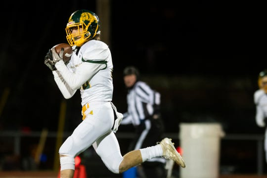 Burr and Burton's Logan Morgan (20) catches a pass during the DI football championship game between St. Johnsbury Hilltoppers and the Burr and Burton Bulldogs at Rutland High School on Saturday evening November 9, 2019 in Rutland, Vermont.