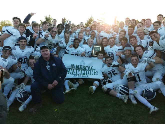 The Middlebury College football team celebrates its NESCAC championship after a 31-24 win over Tufts on Saturday, Nov. 9, 2019.