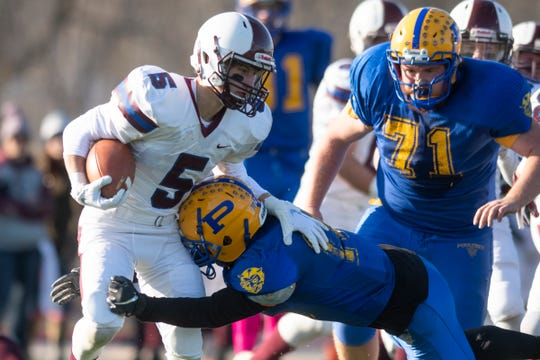 BFA Fairfax's Noah Brock is tackled vey Poultney's Levi Allen (10) during the DIII football championship game between Poultney vs. Fairfax/Lamoille at Rutland High School on Saturday afternoon November 9, 2019 in Rutland, Vermont.