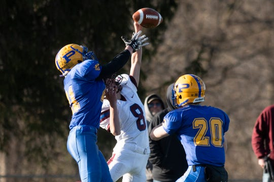Poultney's Lucas Gloss (21) breaks up the pass intended for BFA Fairfax's Shaun Gibson (8) during the DIII football championship game between Poultney vs. Fairfax/Lamoille at Rutland High School on Saturday afternoon November 9, 2019 in Rutland, Vermont.