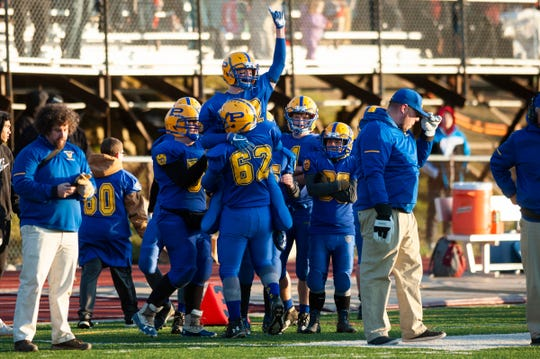 Poultney celebrates during the DIII football championship game between Poultney vs. Fairfax/Lamoille at Rutland High School on Saturday afternoon November 9, 2019 in Rutland, Vermont.