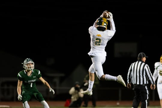 Burr and Burton's John Morgantini (2) leaps to catch the pass during the DI football championship game between St. Johnsbury Hilltoppers and the Burr and Burton Bulldogs at Rutland High School on Saturday evening November 9, 2019 in Rutland, Vermont.