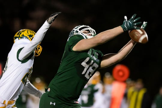 St. Johnsbury's David Hutchinson (48) just misses the pass during the DI football championship game between St. Johnsbury Hilltoppers and the Burr and Burton Bulldogs at Rutland High School on Saturday evening November 9, 2019 in Rutland, Vermont.