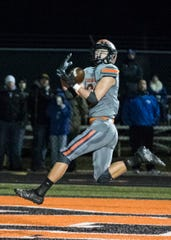 Waverly wide receiver Will Futhey catches a touchdown pass during a 40-0 win over Gallia Academy in a Division IV regional quarterfinal on Saturday, Nov. 9, 2019, in Waverly, Ohio. Waverly will go on to play Bloom Carroll in a regional semifinal.
