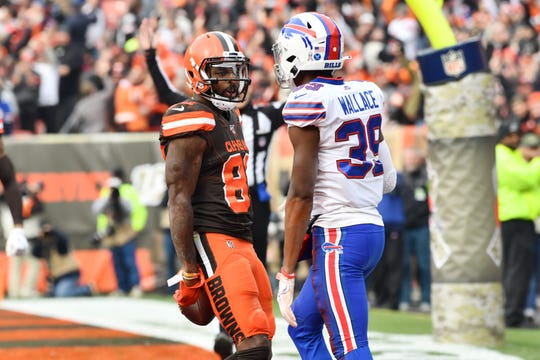 Cleveland Browns wide receiver Jarvis Landry (80) taunts Buffalo Bills cornerback Levi Wallace (39) after catching a touchdown during the first half at FirstEnergy Stadium.