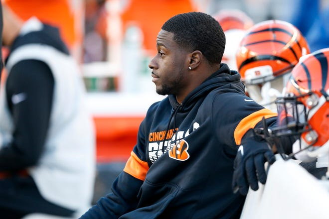 Injured Cincinnati Bengals wide receiver A.J. Green (18) watches from the bench in the fourth quarter of the NFL Week 10 game between the Cincinnati Bengals and the Baltimore Ravens at Paul Brown Stadium in downtown Cincinnati on Sunday, Nov. 10, 2019. The Bengals fell 49-13 to the Ravens and remain winless on the season.