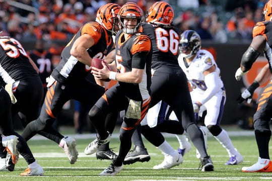 Cincinnati Bengals quarterback Ryan Finley (5) rolls out of the pocket in the first quarter of a Week 10 NFL game against the Baltimore Ravens, Sunday, Nov. 10, 2019, at Paul Brown Stadium in Cincinnati.