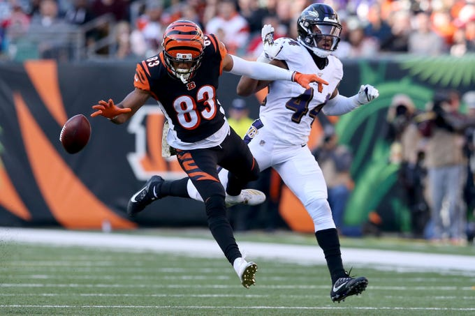 Cincinnati Bengals wide receiver Tyler Boyd (83) is unable to each an overthrown pass as Baltimore Ravens cornerback Marlon Humphrey (44) defends in the third quarter of a Week 10 NFL game, Sunday, Nov. 10, 2019, at Paul Brown Stadium in Cincinnati. The Baltimore Ravens won 49-13. The Cincinnati Bengals remained winless at 0-9 on the season.