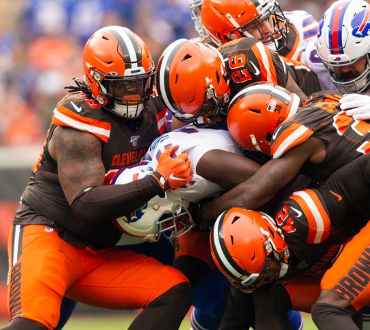Buffalo Bills running back Devin Singletary (26) gets tackled by the Cleveland Browns defense during the second quarter at FirstEnergy Stadium.