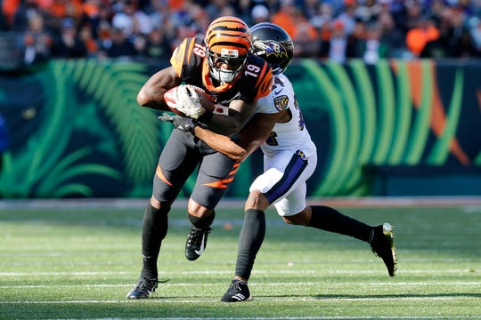 Cincinnati Bengals wide receiver Auden Tate (19) makes a catch against Baltimore Ravens cornerback Brandon Carr (24) in the second quarter of the NFL Week 10 game between the Cincinnati Bengals and the Baltimore Ravens at Paul Brown Stadium in downtown Cincinnati on Sunday, Nov. 10, 2019.