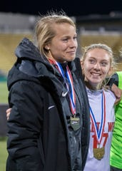 Lakota West head coach Brigit Reder and player Gabbie Boehm wear their medals just prior to the trophy presentation in Columbus Ohio Saturday Nov. 9, 2019. The Lakota West Thunderbirds beat the Anthony Wayne Lady Generals 2-1 on a goal with 13 seconds to go to win the Division I state championship.