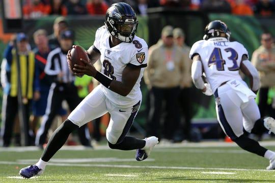 Baltimore Ravens quarterback Lamar Jackson (8) rolls out of the pocket in the second quarter of a Week 10 NFL game against the Cincinnati Bengals, Sunday, Nov. 10, 2019, at Paul Brown Stadium in Cincinnati.