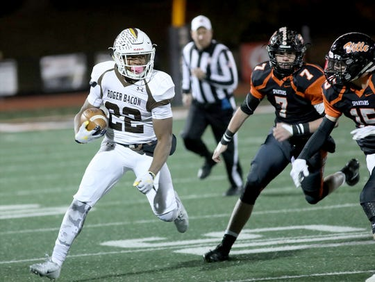 Roger Bacon's Corey Kiner runs the ball during the playoff game against Waynesville Saturday, Nov. 9, 2019.