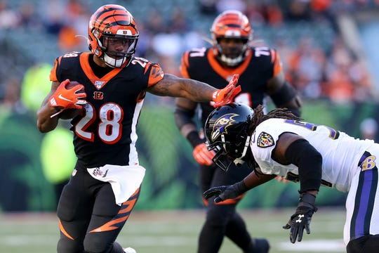 Cincinnati Bengals running back Joe Mixon (28) carries the ball in the fourth quarter of a Week 10 NFL game against the Cincinnati Bengals, Sunday, Nov. 10, 2019, at Paul Brown Stadium in Cincinnati. The Baltimore Ravens won 49-13. The Cincinnati Bengals remained winless at 0-9 on the season.