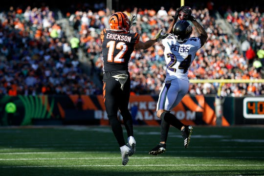 Baltimore Ravens cornerback Brandon Carr (24) intercepts a pass intended for Cincinnati Bengals wide receiver Alex Erickson (12) before running it back for a touchdown in the second quarter of the NFL Week 10 game between the Cincinnati Bengals and the Baltimore Ravens at Paul Brown Stadium in downtown Cincinnati on Sunday, Nov. 10, 2019.