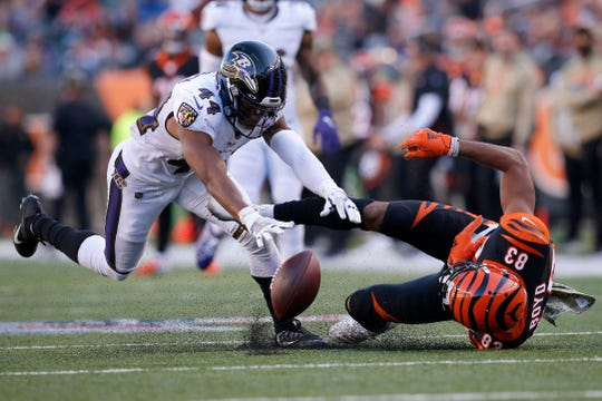 Baltimore Ravens cornerback Marlon Humphrey (44) breaks up a pass intended for Cincinnati Bengals wide receiver Tyler Boyd (83) as they collide in the fourth quarter of the NFL Week 10 game between the Cincinnati Bengals and the Baltimore Ravens at Paul Brown Stadium in downtown Cincinnati on Sunday, Nov. 10, 2019. The Bengals fell 49-13 to the Ravens and remain winless on the season.