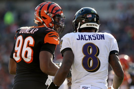 Cincinnati Bengals defensive end Carlos Dunlap (96) talks to Baltimore Ravens quarterback Lamar Jackson (8) in the second quarter of a Week 10 NFL game, Sunday, Nov. 10, 2019, at Paul Brown Stadium in Cincinnati.