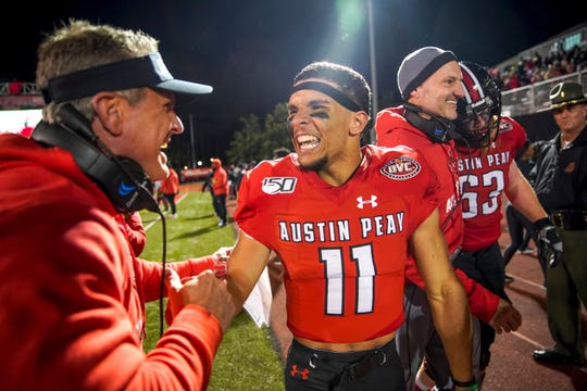 Austin Peay head coach Mark Hudspeth celebrates with Austin Peay's DeAngelo Wilson (11) after a big play at APSU's homecoming game against the UT Martin Skyhawks at Fortera Stadium in Clarksville, Tenn., on Saturday, Nov. 9, 2019. | henrytaylor@theleafchronicle.com