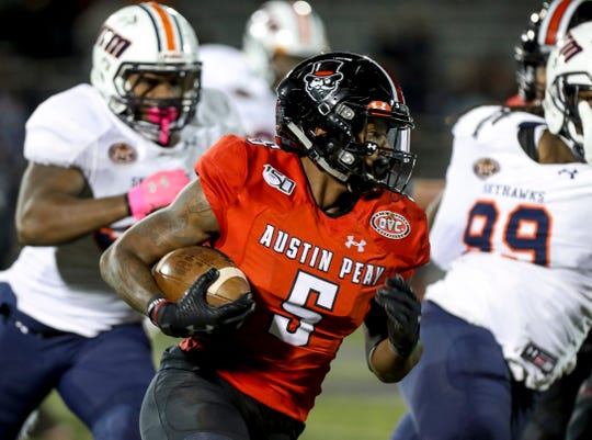 Austin Peay's Kentel Williams moves through the UT Martin defense at APSU's homecoming game against the UT Martin Skyhawks at Fortera Stadium in Clarksville, Tenn., on Saturday, Nov. 9, 2019. | henrytaylor@theleafchronicle.com