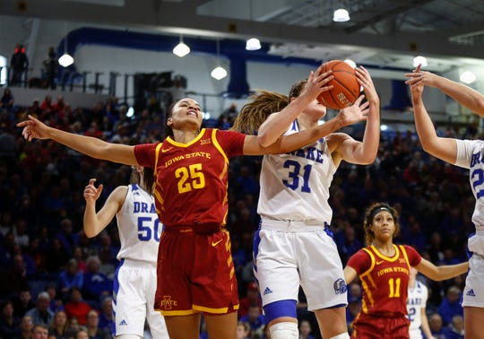 Drake senior Monica Burich pulls a rebound away from Iowa State junior Kristin Scott in the second quarter on Sunday, Nov. 10, 2019, at the Knapp Center in Des Moines.