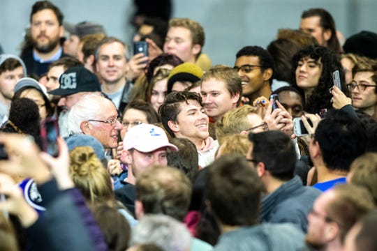 Democratic presidential candidate U.S. Sen. Bernie Sanders, I-Vt., poses for a selfie with a supporter after speaking during a campaign rally, Saturday, Nov., 9, 2019, at the Coralville Mariott Hotel and Conference Center, in Coralville, Iowa.