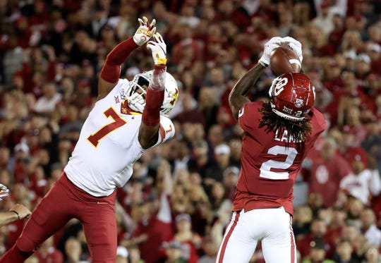 Nov 9, 2019; Norman, OK, USA; Oklahoma Sooners wide receiver CeeDee Lamb (2) catches a touchdown pass past Iowa State Cyclones defensive back Justin Bickham (7) during the first quarter at Gaylord Family - Oklahoma Memorial Stadium. Mandatory Credit: Kevin Jairaj-USA TODAY Sports