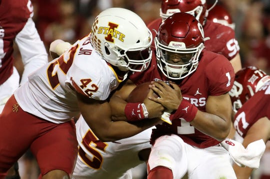 Nov 9, 2019; Norman, OK, USA; Iowa State Cyclones linebacker Marcel Spears Jr. (42) tackles Oklahoma Sooners quarterback Jalen Hurts (1) during the second quarter at Gaylord Family - Oklahoma Memorial Stadium. Mandatory Credit: Kevin Jairaj-USA TODAY Sports