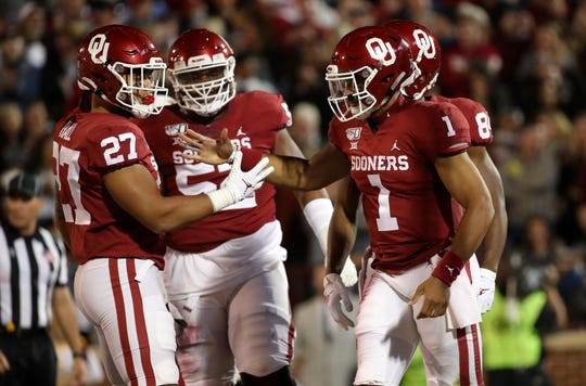 Nov 9, 2019; Norman, OK, USA; Oklahoma Sooners quarterback Jalen Hurts (1) celebrates with fullback Jeremiah Hall (27) after scoring a touchdown during the first quarter against the Iowa State Cyclones at Gaylord Family - Oklahoma Memorial Stadium. Mandatory Credit: Kevin Jairaj-USA TODAY Sports