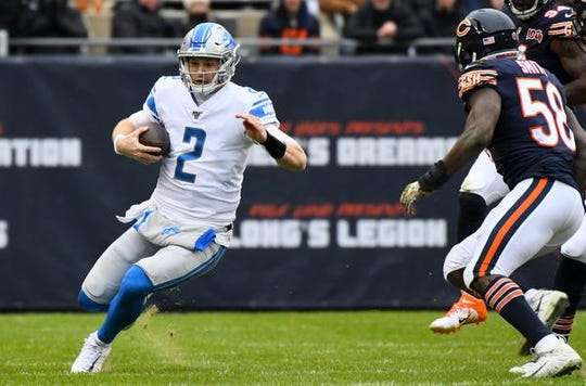 Lions quarterback Jeff Driskel rushes the ball against Bears inside linebacker Roquan Smith during the first quarter on Sunday, Nov. 10, 2019, in Chicago.