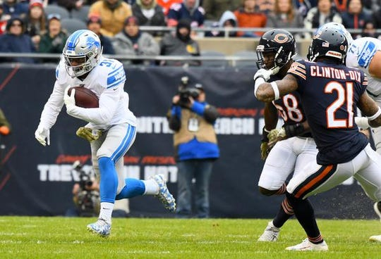 Lions running back Ty Johnson rushes the ball past Bears inside linebacker Roquan Smith during the first quarter on Sunday, Nov. 10, 2019, in Chicago.