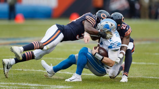 Jeff Driskel is sacked by Bears linebacker Roquan Smith, left, and safety Ha Ha Clinton-Dix during the second half Sunday in Chicago.