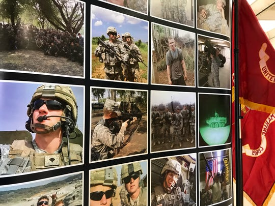 One of the displays of nearly 200 photographs submitted for a photo exhibit by Macomb Community College students of their experiences in the Armed Forces to recognize Veterans Day.