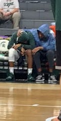 Michigan State guard Cassius Winston, left, and his brother, Albion College guard Khy Winston, sit on the bench before the game against Binghamton on Sunday, Nov. 10, 2019.