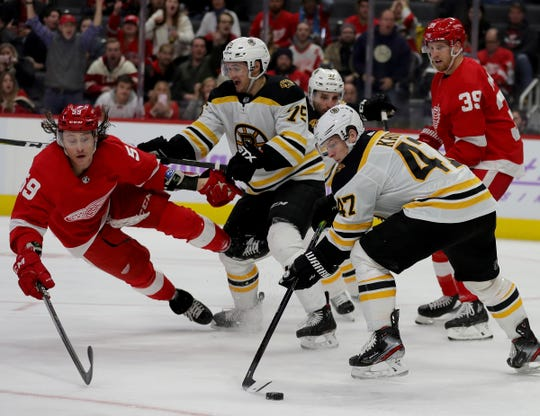 Detroit Red Wings left wing Tyler Bertuzzi defends Boston Bruins defenseman Torey Krug during the third period Nov. 8, 2019 at Little Caesars Arena.