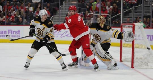 Detroit Red Wings left wing Justin Abdelkader is defended by Boston Bruins defenseman Torey Krug and goaltender Tuukka Rask during the third period Nov. 8, 2019 at Little Caesars Arena.