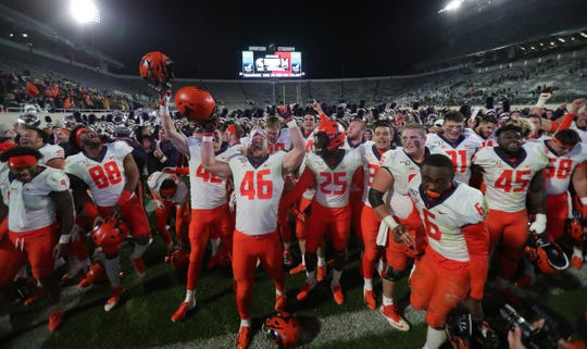 The Illinois Fighting Illini celebrate the 37-34 win over the Michigan State Spartans, Saturday, Nov. 9, 2019 at Spartan Stadium in East Lansing.