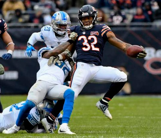 Lions strong safety Tavon Wilson tackles Bears running back David Montgomery in the second half of the Lions' 20-13 loss on Sunday, Nov. 10, 2019, in Chicago.