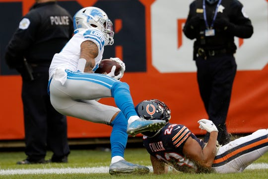 Lions receiver Kenny Golladay catches a 47-yard touchdown pass as Bears cornerback Kyle Fuller defends during the second half Sunday, Nov. 10, 2019, in Chicago.