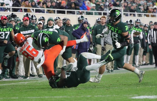 Michigan State Spartans linebacker Noah Harvey (45) tackles Illinois Fighting Illini wide receiver Donny Navarro (86) during second half action Saturday, November 9, 2019 at Spartan Stadium in East Lansing, Mich.